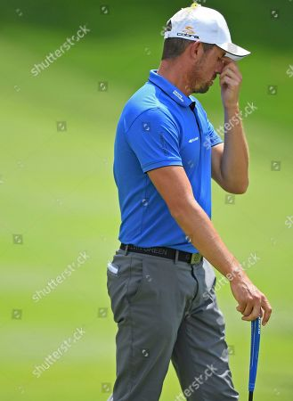 Alexander Bjork, from Sweden, reacts after missing a putt on the 18th hole during the first round of the Bridgestone Invitational golf tournament at Firestone Country Club, in Akron, Ohio