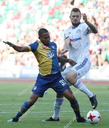 Filipp Ivanov (R) of FC Dinamo Minsk in action against Erick Davis (L) of FC DAC 1904 Dunajska Streda during the UEFA Europa League soccer match between FC Dinamo Minsk and FC DAC 1904 Dunajska Streda in Minsk, Belarus, 02 August 2018