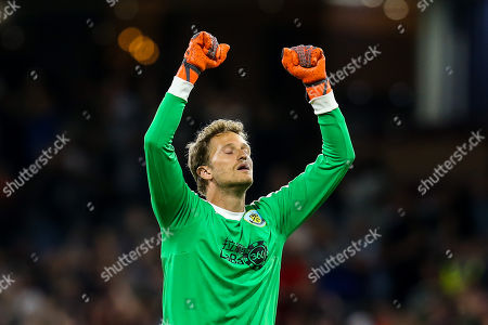 Stock Picture of Anders Lindegaard of Burnley celebrates Jack Cork scoring a goal to make it 2-1