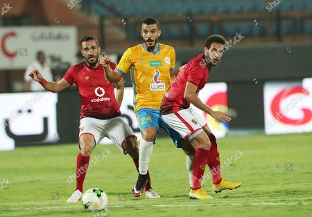 Al Ahly player Ali Maaloul (L) Hisham Mohamed  (R) in action against  Ismaily player Shokry Naguib  (C) during their Egyptian league football match between Al Ahly and Ismaily in Cairo, Egypt, 02 August 2018.