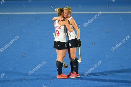 Alex Danson of England and Susannah Townsend of England embrace at full-time