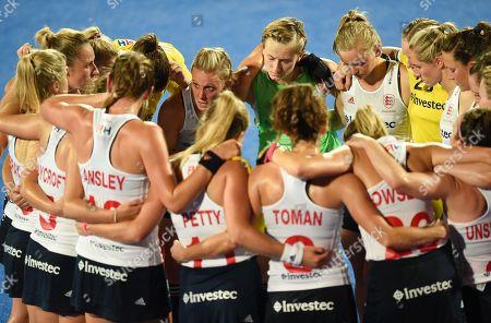 An emotional Alex Danson of England speaks to team-mates