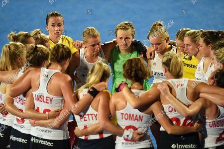 An emotional Alex Danson of England talks to team-mates