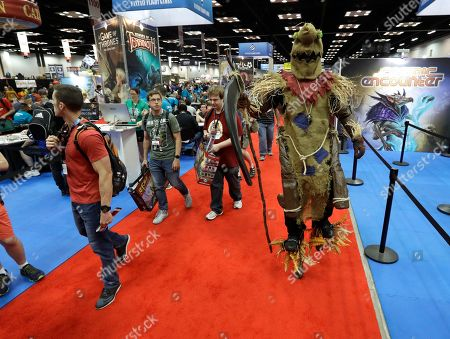 Lemmy Taylor, right, walks through the display area during the 51st annual Gen Con convention, in Indianapolis. The convention runs through Sunday, Aug. 5