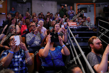 Supporters use their smartphones to record while listening to New York congressional candidate Alexandria Ocasio-Cortez at a fundraiser, in Los Angeles. The 28-year-old startled the party when she defeated 10-term U.S. Rep. Joe Crowley in a New York City Democratic primary