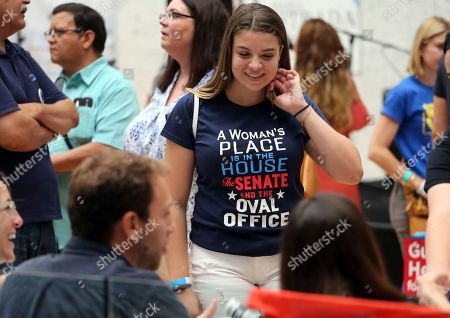 "Stock Photo of Melainey Jane Foerster, who describes herself on her business card as ""just an average teenage feminist liberal environmentalist,"" attends a speech by New York congressional candidate Alexandria Ocasio-Cortez at a fundraiser in Los Angeles . The rising liberal star startled the party when she defeated 10-term U.S. Rep. Joe Crowley in a New York City Democratic primary. Ocasio-Cortez urged a cheering crowd to work together for universal health care and free college, and not to be deterred by those who say they can't be achieved"
