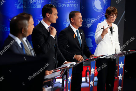 Democratic gubernatorial candidates, from right, Gwen Graham, Philip Levine, Chris King, Jeff Greene and Andrew Gillum await the start of a debate ahead of the Democratic primary for governor, in Palm Beach Gardens, Fla