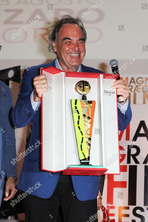 Oliver Stone honored with a glass sculpture