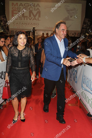 Oliver Stone with his wife Sun-jung Jung