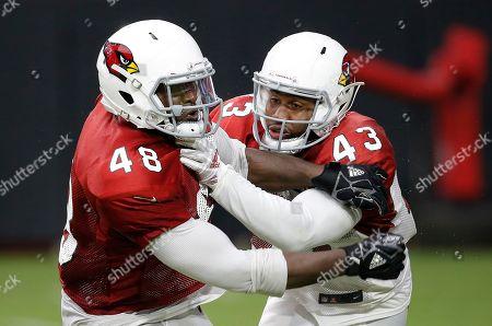 Arizona Cardinals linebacker Haason Reddick (43) defends running back Derrick Coleman (48) during an NFL football practice, in Glendale, Ariz