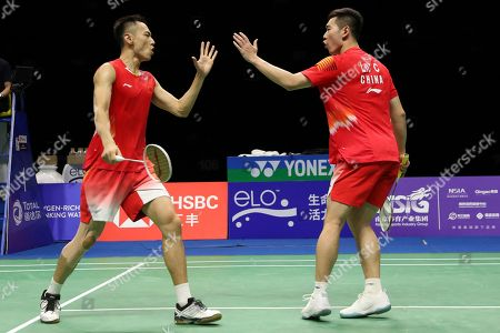 Liu Cheng, Zhang Nan. Zhang Nan, left, and Liu Cheng of China react as they compete against Mads Conrad-Petersen and Mads Pieler Kolding of Denmark in their men's badminton doubles quarterfinal match at the BWF World Championships in Nanjing, China