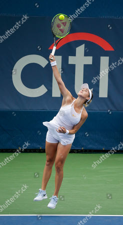 Belinda Bencic serves the ball during a Citi Open tennis match at Rock Creek Park in Washington DC