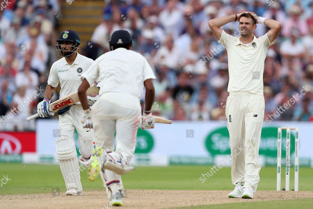 James Anderson of England shows a look of dejection as Ravichandran Ashwin and Virat Kohli of India add runs to their teams total