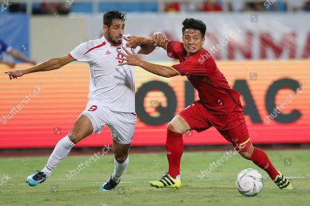 Stock Picture of Vietnam's Bui Tien Dung (R) fights for the ball with Palestine's Oday I.M. Dabbagh during the match between Vietnam and Palestine at the Vietnam Football Federation (VFF) International U23 soccer tournament, in Hanoi, Vietnam 03 August 2018. The tournament takes place at My Dinh National Stadium from 03 to 07 August, gathering four U23 teams, including reigning Asian champions Uzbekistan, reigning Asian runners-up Vietnam, Palestine and Oman.