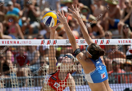Stock Photo of United States's Sara Hughes, rear, plays the ball past Italy's Viktoria Orsi Toth, front, at the Beachvolley Worldtour Major Series, in Vienna, Austria