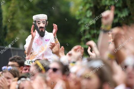 A festival-goer in an Osama Bin Laden fancy dress costume during Lucy Spraggan's performance