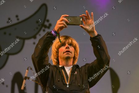 The Charlatans - Tim Burgess takes a photograph with a smart phone