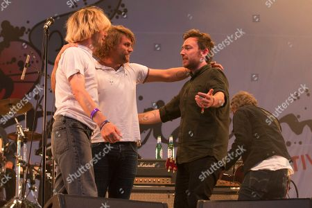The Charlatans and Frightened Rabbit embrace after performing a Frightened Rabbit song in tribute to the late Scott Hutchison, lead singer of Frightened Rabbit - Tim Burgess, Grant Hutchison and Billy Kennedy