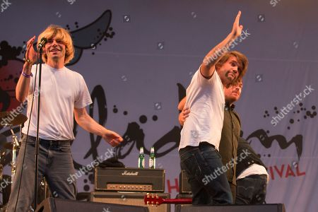 Stock Image of The Charlatans and Frightened Rabbit perform a Frightened Rabbit song in tribute to the late Scott Hutchison, lead singer of Frightened Rabbit - Tim Burgess, and Grant Hutchison and Billy Kennedy wave as they leave the stage