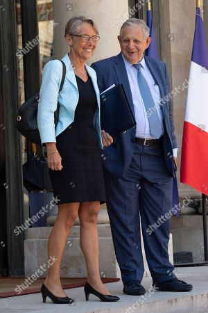 French Transports Minister Elisabeth Borne and French Minister for Territorial Cohesion Jacques Mezard leave after the weekly cabinet meeting at the Elysee Palace