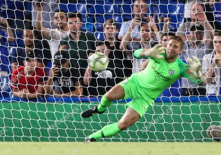 Robert Green of Chelsea saves a penalty during the shootout