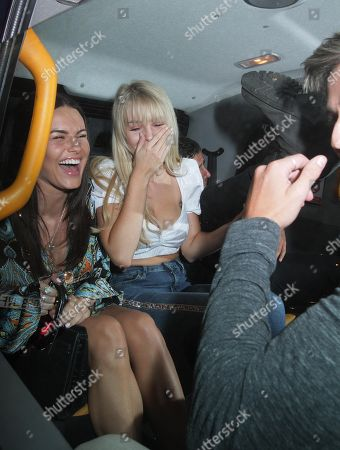 Lottie Moss and Emily Blackwell laugh as Alik Alfus puts his leg in the air