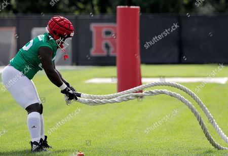 Rutgers defensive lineman Matt Thomas works out during college football training camp, in Piscataway, N.J