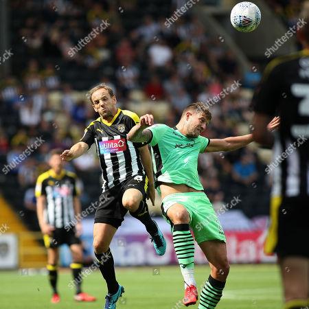 David Vaughan battles for the ball for Notts
