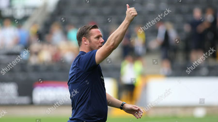 Kevin Nolan gives a thumbs up to the Meadow Lane crowd at full time