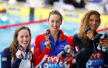 Bronze medalist Hannah Miley of Great Britain, gold medalist Fantine Lesaffre of France and Ilaria Cusinato of Italy pose with their medals after the 400 meters individual medley women final at the European Swimming Championships in Glasgow, Scotland
