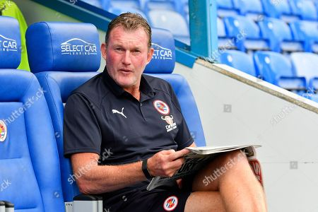 Reading goalkeeping coach Dave Beasant reading a newspaper before the EFL Sky Bet Championship match between Reading and Derby County at the Madejski Stadium, Reading. Picture by Graham Hunt