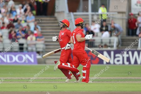 Lancashires Alex Davies & Lancashires Karl Brown running between the wicket during the Vitality T20 Blast North Group match between Lancashire Lightning and Leicestershire Foxes at the Emirates, Old Trafford, Manchester. Picture by George Franks