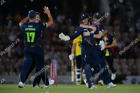 Adam Milne, Sam Billings, and Marcus Stoinis of Kent celebrate the wicket of Chris Wood during the Vitality T20 Blast South Group match between Hampshire CCC and Kent Spitfires at the Ageas Bowl, Southampton. Picture by Dave Vokes