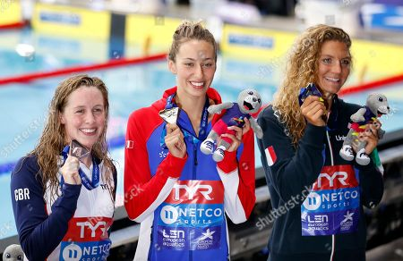 France's Fantine Lesaffre, center, celebrates her gold medal in 400m Individual Medley with second placed Ilaria Cusinato from Italy, right and third Hannah Miley from Britain, at the European Swimming Championships in Glasgow, Scotland