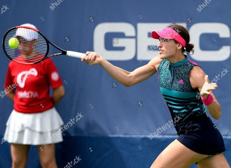 Andrea Petkovic, of Germany, returns the ball against Belinda Bencic, of Switzerland, during the Citi Open tennis tournament, in Washington