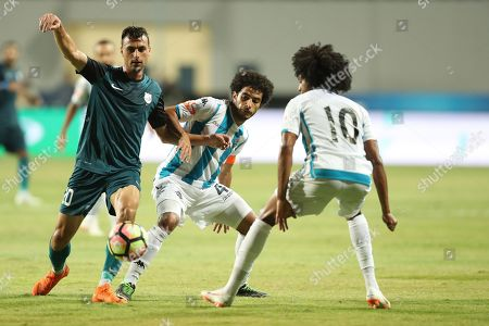 Enppi player Mahmoud Kaoud  (L) n action against  Pyramids player Keno (R) and Omar Gaber (C) during their Egyptian league football match  between Enppi  and   Pyramids in Cairo, Egypt, 03 August 2018.