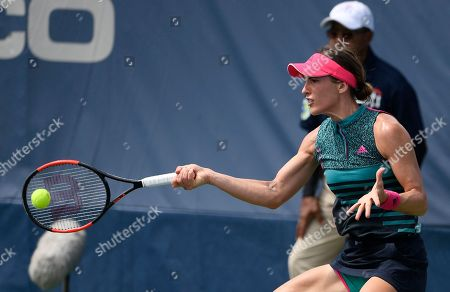 Kevin Anderson, Alexander Zverev. Andrea Petkovic, of Germany, returns a shot against Belinda Bencic, of Switzerland, during the Citi Open tennis tournament, in Washington