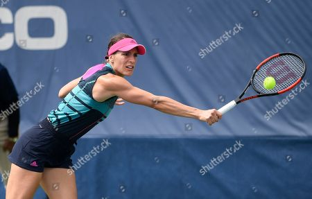 Kevin Anderson, Alexander Zverev. Andrea Petkovic, of Germany, reaches for the ball during the Citi Open tennis tournament against Belinda Bencic, of Switzerland, in Washington