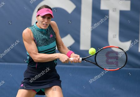 Kevin Anderson, Alexander Zverev. Andrea Petkovic, of Germany, returns the ball against Belinda Bencic, of Switzerland, during the Citi Open tennis tournament, in Washington