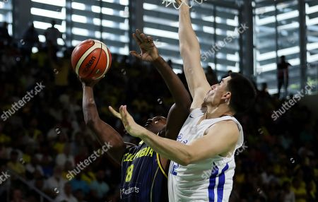 Jorge Diaz (R) of Puerto Rico vies for the ball with the Colombian Michael Jackson (L) during the match for the gold medal of the Men's Basketball at the 23rd Central American and Caribbean Games Barranquilla 2018, in Barranquilla, Colombia, 03 August 2018.