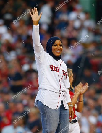 US Olympic Bronze medalist Ibtihaj Muhammad waves to the crowd before throwing out the first pitch of the game between the Boston Red Sox and the New York Yankees at Fenway Park in Boston, Massachusetts, USA, 03 August 2018.