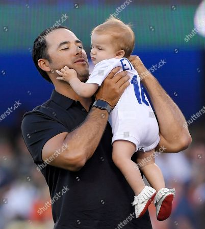 Stock Image of Andre Ethier, Anson Ethier. Los Angeles Dodgers' Andre Ethier holds his son Anson during a retirement ceremony for him prior to a baseball game between the Dodgers and the Houston Astros, in Los Angeles