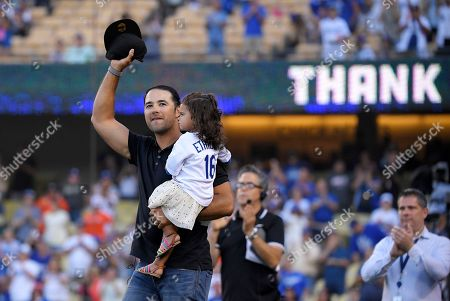 Andre Ethier, Everly Ethier. Los Angeles Dodgers' Andre Ethier, left, gestures to fans as holds his daughter Everly during a retirement ceremony for him prior to a baseball game between the Dodgers and the Houston Astros, in Los Angeles
