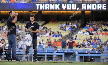 Andre Ethier, Jason Bateman. Los Angeles Dodgers' Andre Ethier, left, gestures to fans as he stands alongside actor Jason Bateman during a retirement ceremony for him prior to a baseball game between the Dodgers and the Houston Astros, in Los Angeles