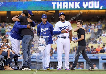 Andre Ethier, Jason Bateman, Kenley Jansen, Clayton Kershaw, Matt Kemp. Los Angeles Dodgers' Andre Ethier, second from eft, hugs Kenley Jansen, left, as Clayton Kershaw, center, Matt Kemp, second from right, and actor Jason Bateman stand by during a retirement ceremony for Ethier prior to a baseball game between the Dodgers and the Houston Astros, in Los Angeles