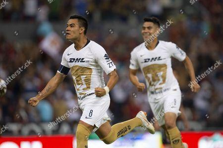 Pablo Barrera (L) of Pumas UNAM celebrates after scoring a goal during the Apertura Tournament soccer match between Atlas and Pumas UNAM at the Jalisco Stadium, in Guadalajara, Mexico, 03 August 2018.