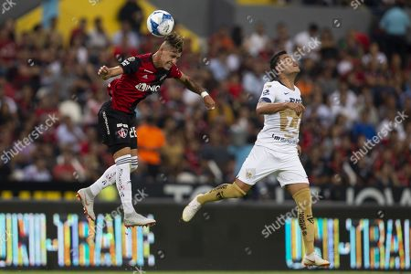 Pablo Barrera (R) of Pumas UNAM vies for the ball with Cristian Calderon (L) of Atlas during the Apertura Tournament soccer match between Atlas and Pumas UNAM at the Jalisco Stadium, in Guadalajara, Mexico, 03 August 2018.