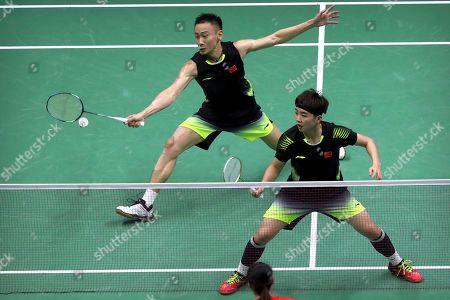Li Yinhui, Zhang Nan. Zhang Nan of China, left, plays a shot as he competes with his partner Li Yinhui against Zheng Siwei and Huang Yaqiong of China in their badminton mixed doubles semifinal match at the BWF World Championships in Nanjing, China
