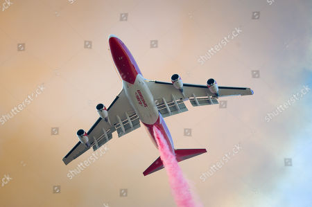 A super tanker begins a fire retardant drop on The River Fire near Scott's Valley Road in Lake County California