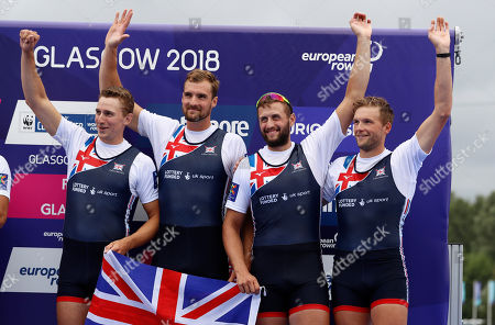 Thomas Ford, Jacob Dawson, Adam Neill and James Johnston, of Great Britain, celebrate on the podium after finishing second in the Men's Four race final at the European Rowing Championships in Glasgow, Scotland